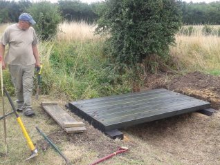 Ben inspects the decking for alignment before it is secured to the bearers