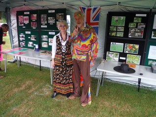 Peter and Maureen in the Hollingbourne Meadows Trusts marquee appropriately dressed in the fetes sixties theme