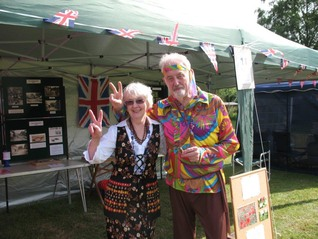 Peter and Maureen outside the Hollingbourne Meadows Trusts marquee appropriately dressed in the fetes Swinging Sixties theme