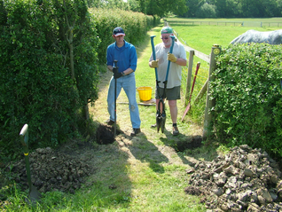 Malcolm and Allan digging the post holes for a new gate