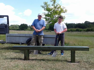 Ben and Shaun standing behind the newly installed bench