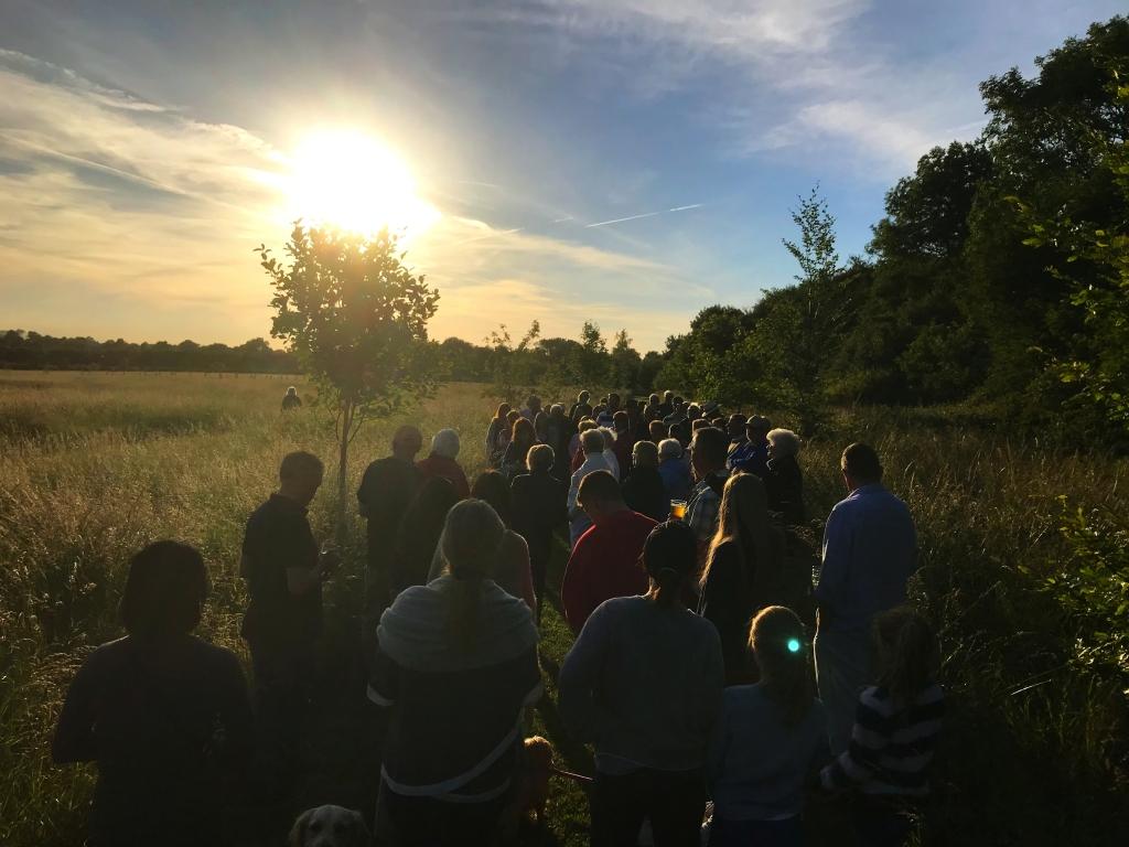 Gathering around the W.I. Tree to sing Jerusalem